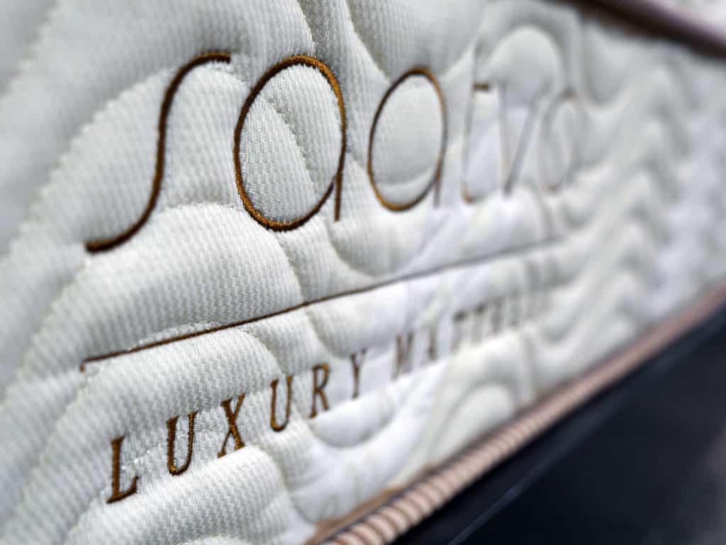 Ultra close up shot of the Saatva mattress logo