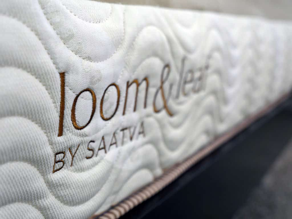 Ultra close up shot of the Loom & Leaf mattress logo