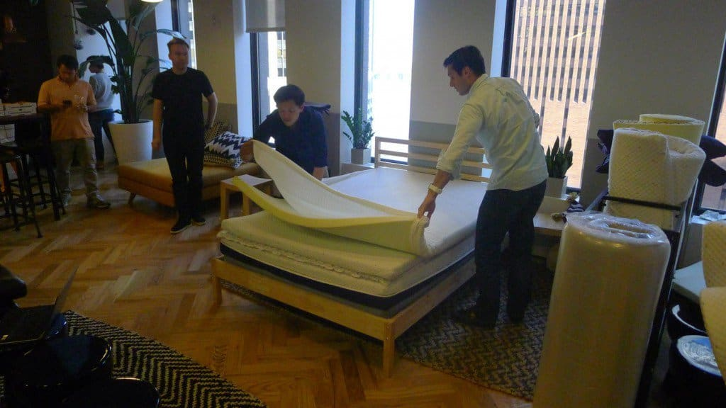Helix Sleep founders, Jerry Lin (left) and Kristian von Rickenbach (right), at Helix Sleep's NYC showroom customizing a mattress for a customer.