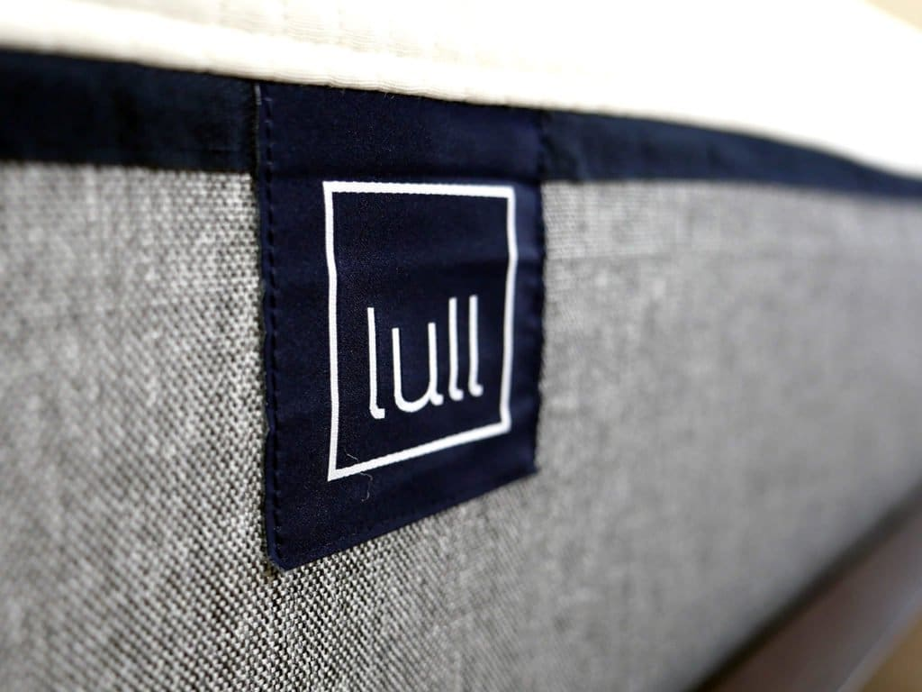 Ultra close up shot of the Lull mattress logo