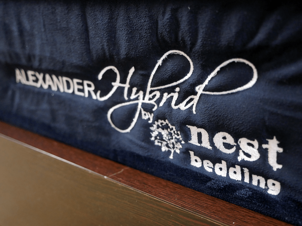 Close up shot of the Nest Alexander hybrid logo