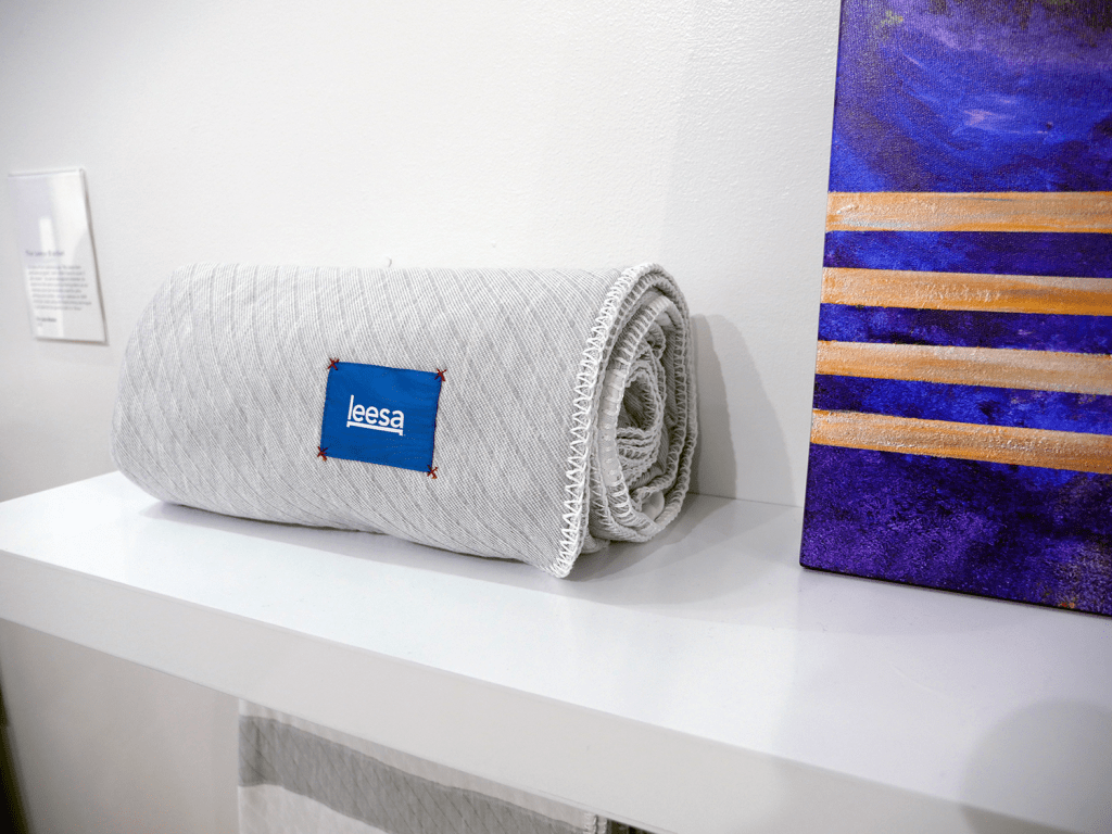 The newly released Leesa blanket is showcased next to a piece of art at their new Dream Gallery
