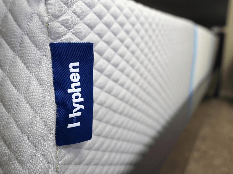 Close up shot of the Hyphen mattress logo