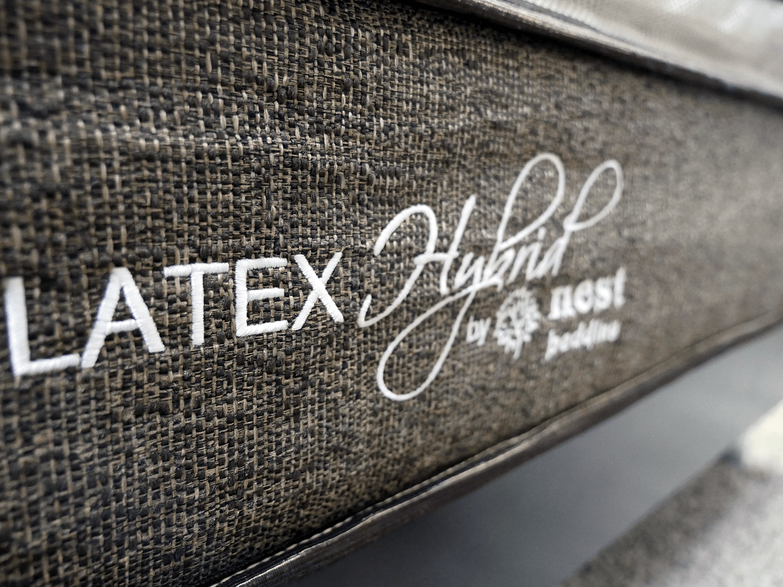 Close up shot of the Nest latex hybrid mattress logo