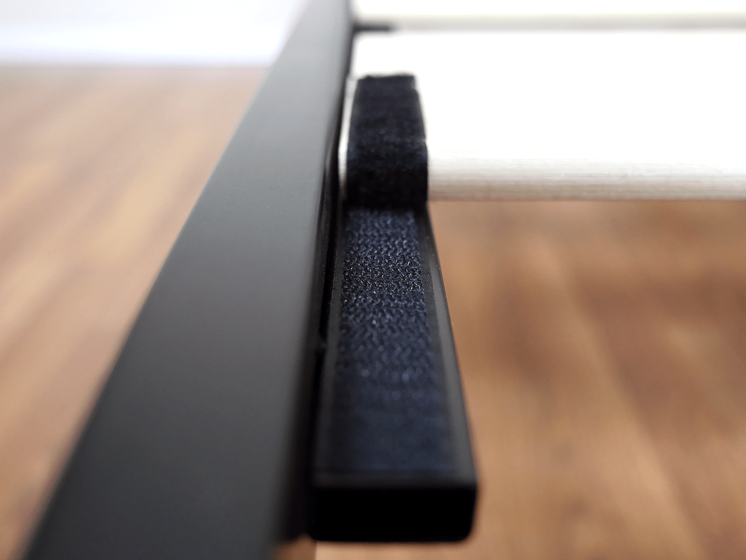Close up shot of the velcro straps used to secure the wood on the Zinus platform bed
