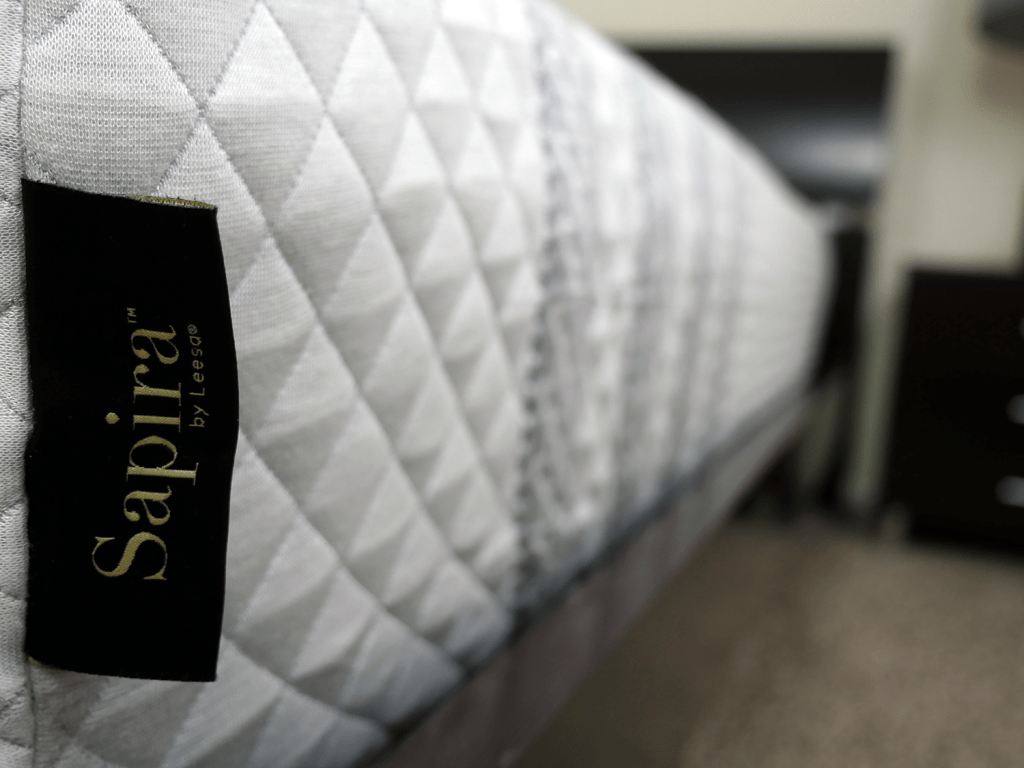 Close up shot of the Sapira mattress logo