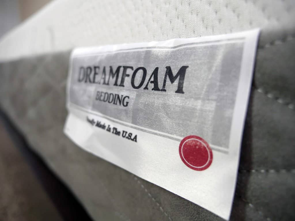 Ultra close up shot of the Ultimate Dreams Supreme Gel mattress logo