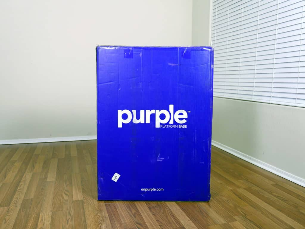 Purple platform bed in the box. Box is actually Purple, camera made it look more blue.