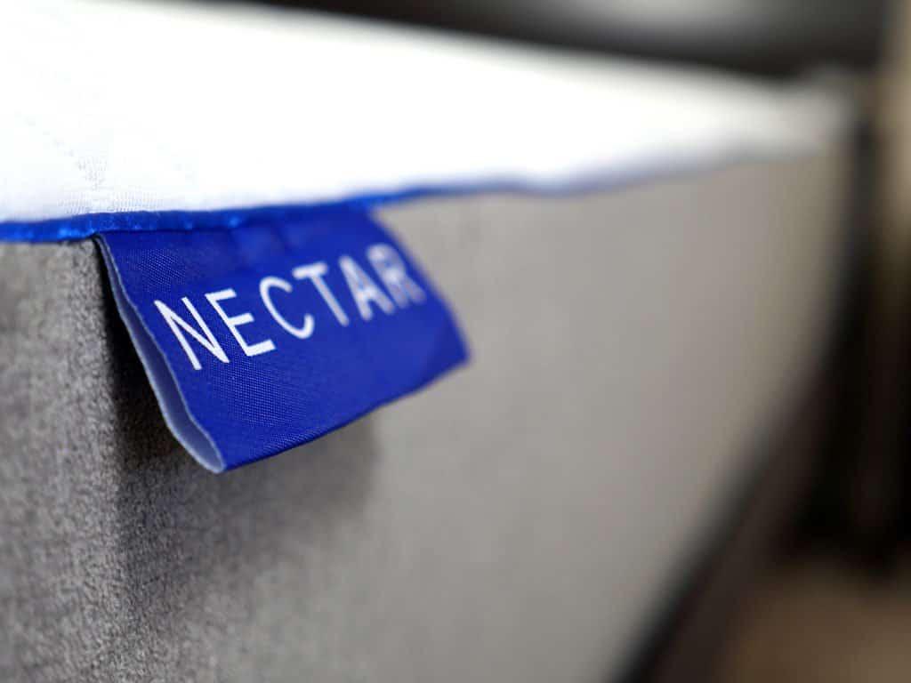 Ultra close up shot of the Nectar mattress logo