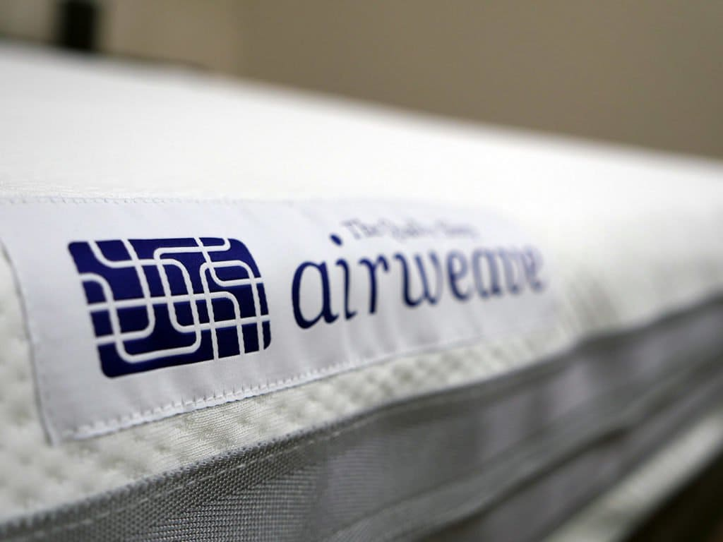 Ultra close up shot of the Airweave mattress logo
