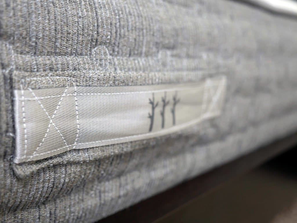 Ultra close up shot of the handles affixed to the cover of the Sierra mattress