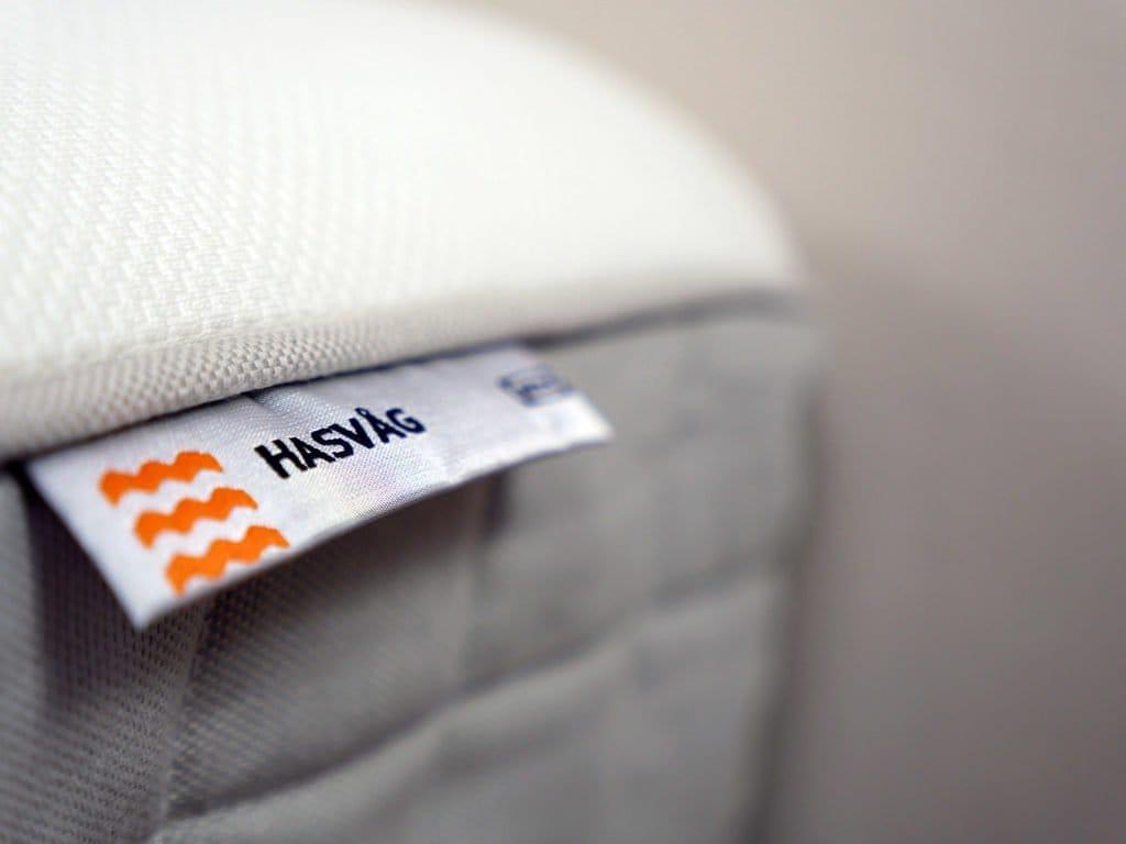 Ultra close up shot of the Hasvag mattress logo