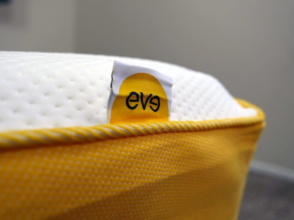 Ultra close up shot of the Eve mattress logo