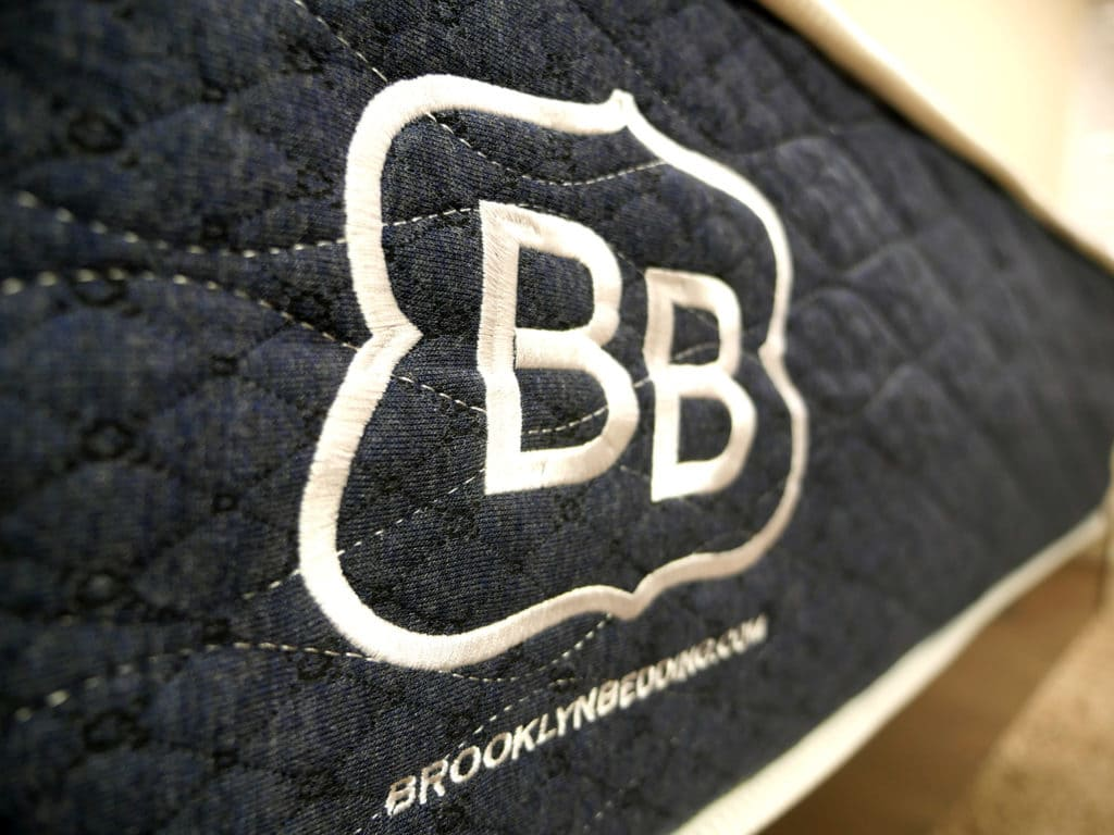 Ultra close up shot of the Brooklyn Bedding logo