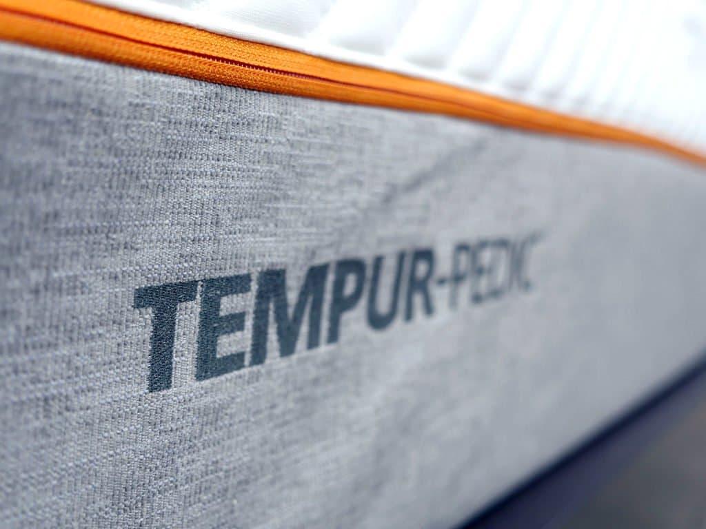 ultra close up shot of the tempurpedic contour rhapsody luxe mattress logo