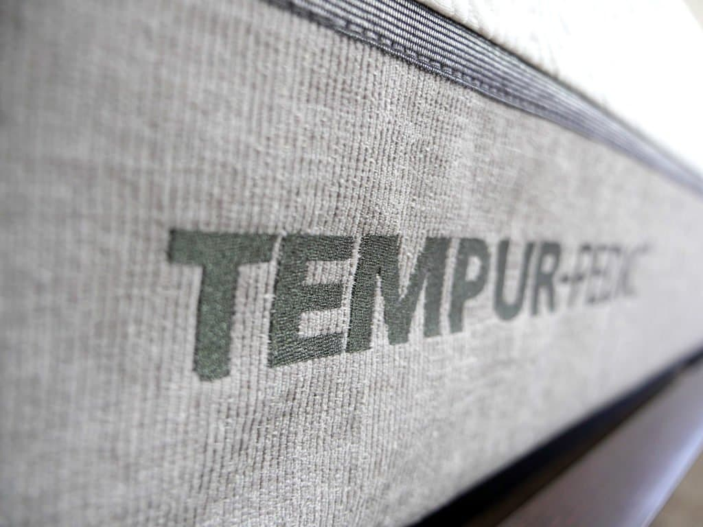 Ultra close up shot of the Tempurpedic Legacy mattress logo