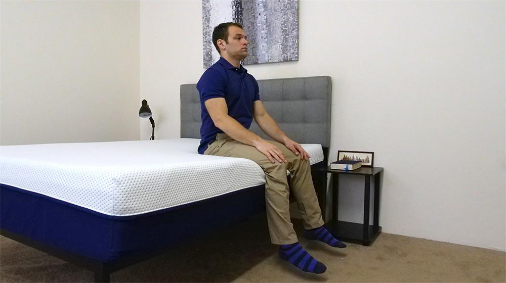 Sitting on the Amerisleep AS3 mattress