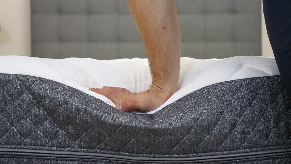 GhostBed Luxe Mattress hand press