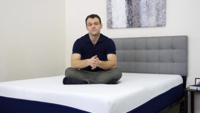 Amerisleep-Comparison-Sitting-On-Bed-400x225 Best Mattress Canada