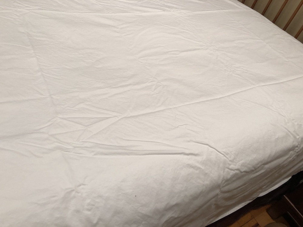 cloudten luna percale flat sheet on bed