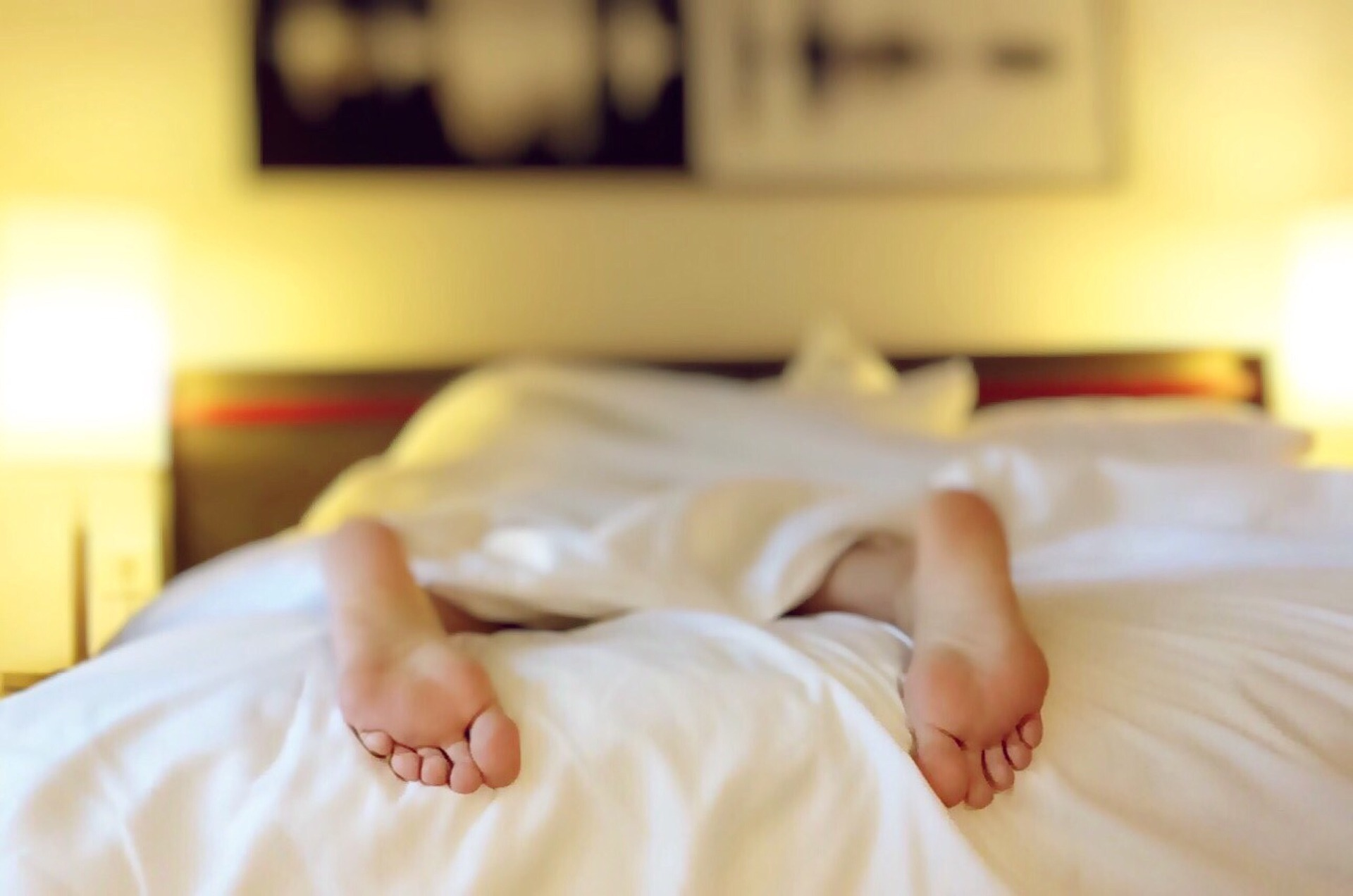 A photo of legs from a person sleeping