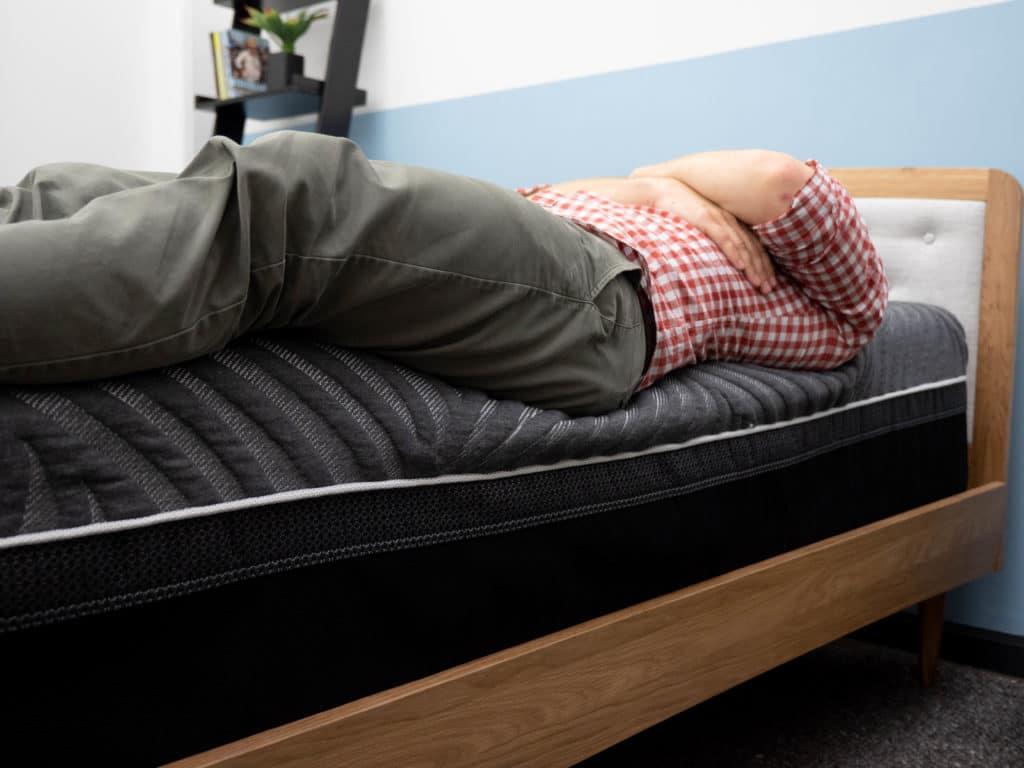 Backing sleeping on Sealy Hybrid Premium mattress