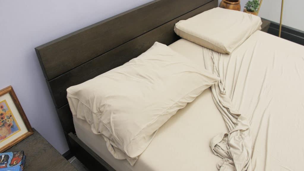 Purple Sheet On Bed