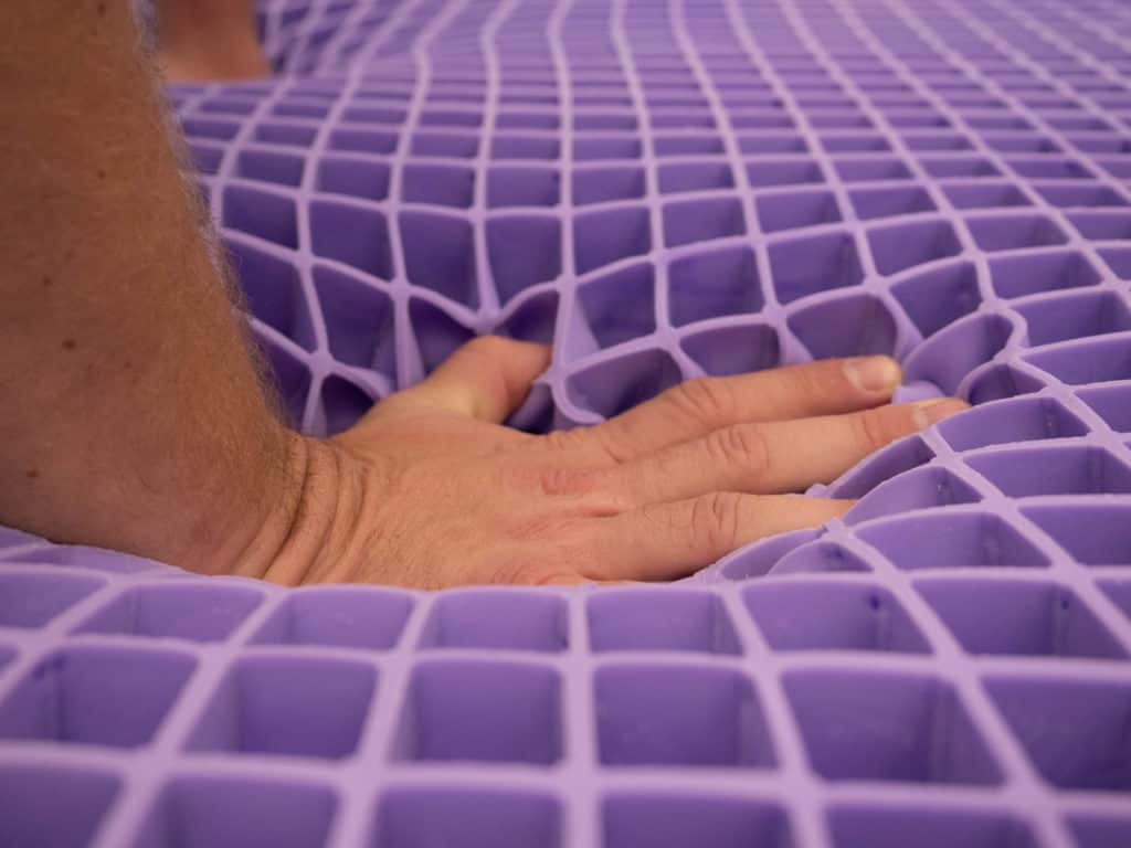 Purple mattress hand press