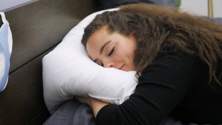 Stomach sleeping on a pillow