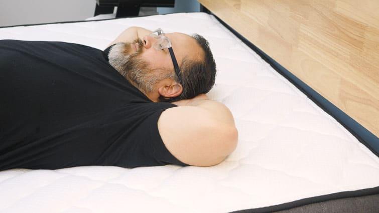 Paulie back sleeping on the Brooklyn Bedding Titan mattress