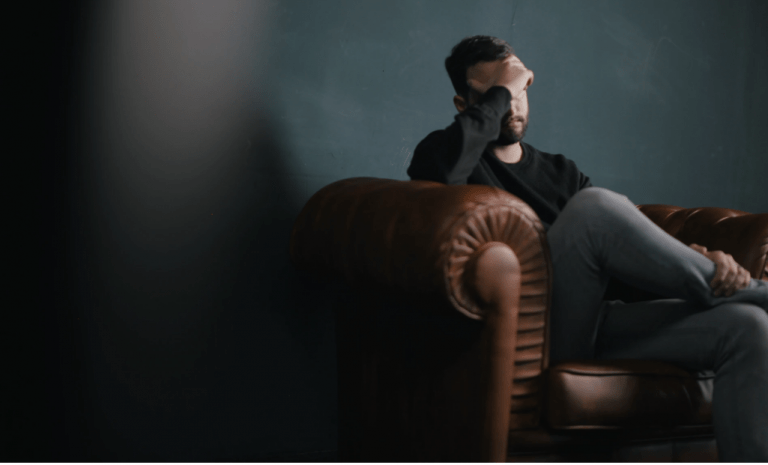 Mental health article featured image, man on chair