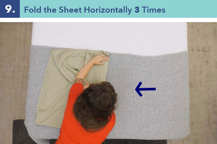 Smooth the fabric, and fold the sheet vertically three times.
