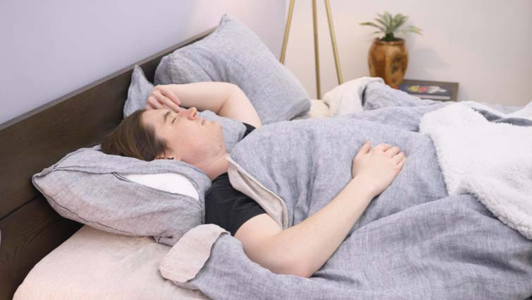 Relaxing in bed after testing best natural sleep aids.