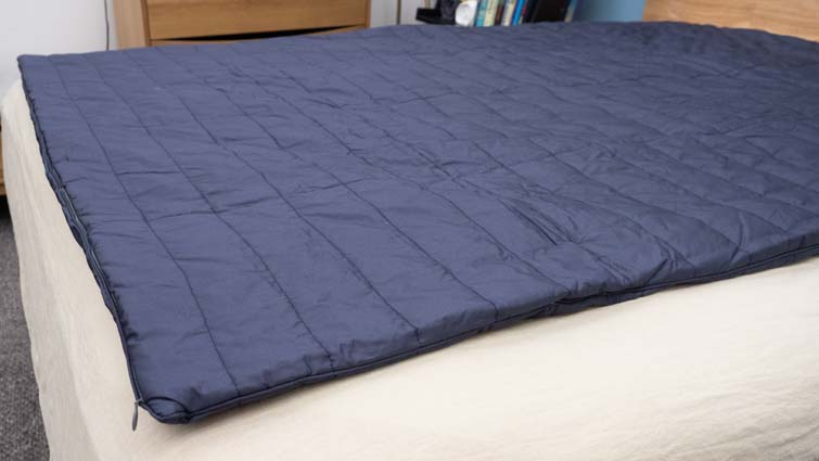 The Sleep Number True Temp weighted blanket on a bed