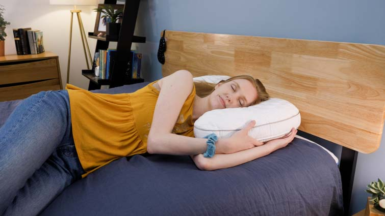 Side sleeping on the bear contour pillow