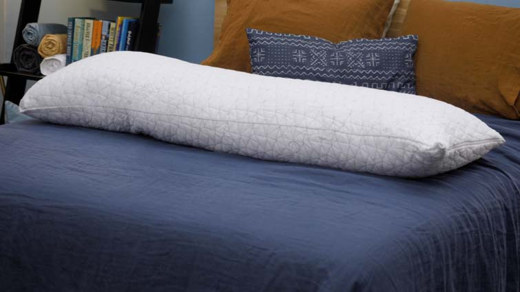 The Coop Home Goods body pillow on a bed