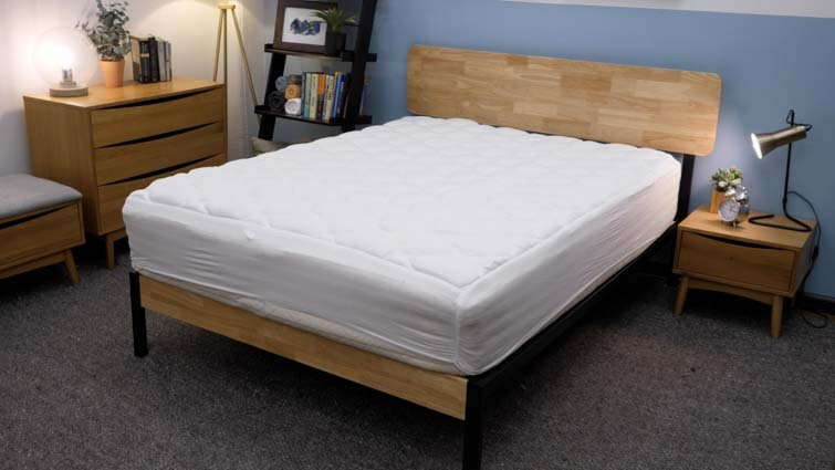 The Helix Plush mattress topper on bed